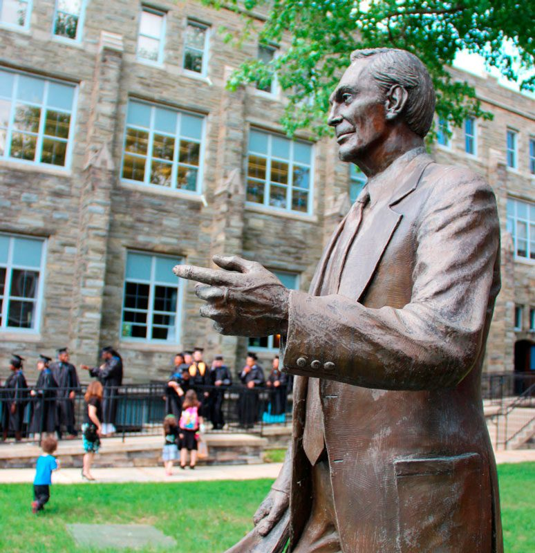 Statue of Walter R. Garrison, founder of P.I.T., on campus during graduation ceremony.