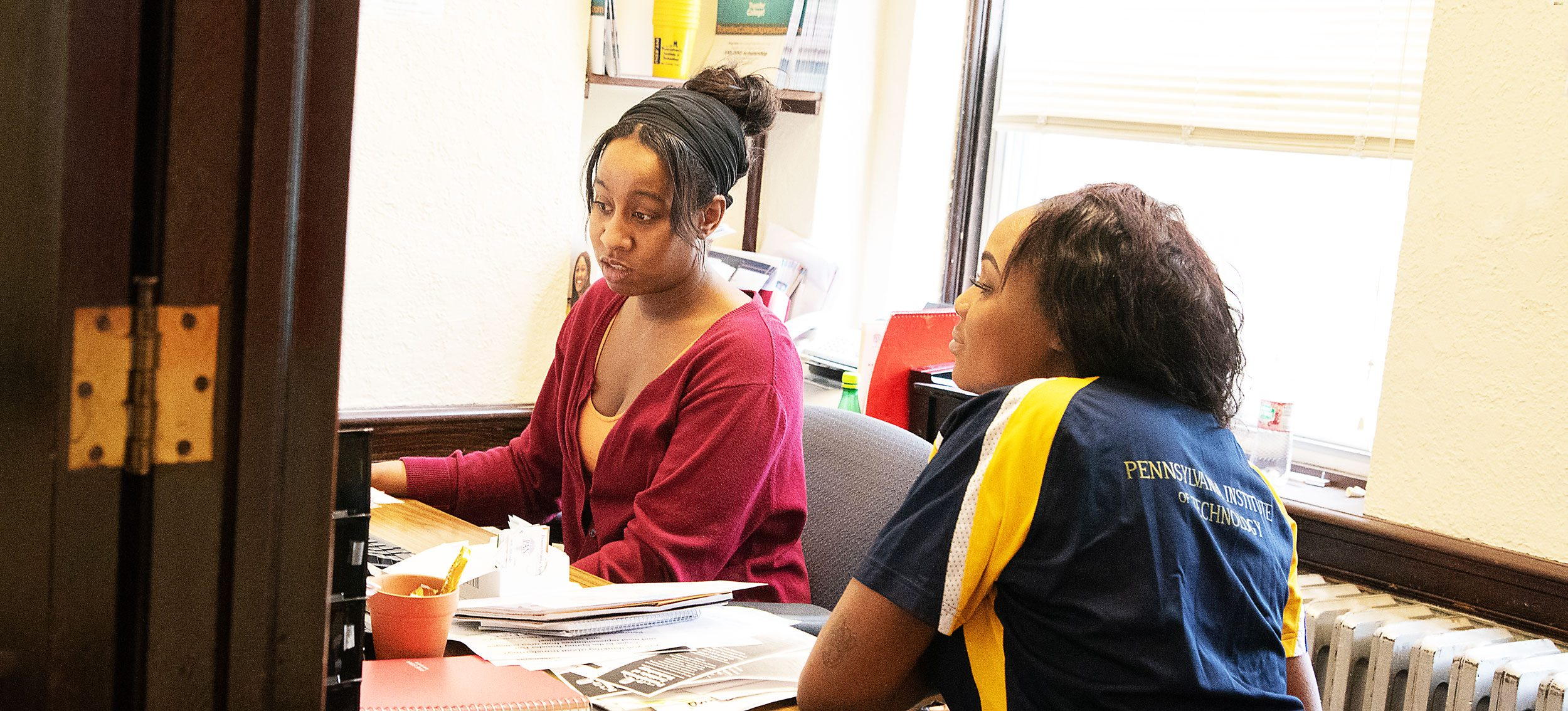 Student discussing financial aid with advisor.